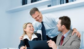 Happy business team working together during a meeting in office with satisfaction