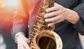 International jazz day and World Jazz festival. Saxophone, music instrument played by saxophonist player musician in fest.; Shutterstock ID 571872670; Purchase Order: 2490; Job: sax; Client/Licensee: spy